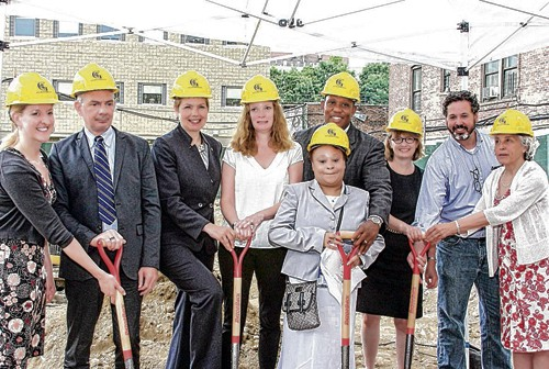 (l-r) Jennifer Trapinski, Benjamin Charvat, MOVA Commissioner Loree Sutton, Tori Lyon, Lisa Spencer, Maurice Coleman, HPD Commissioner Vicki Been, Eric Bederman and Lynthia Romney at Tuesday's groundbreaking ceremony for Jericho Project's new residence on 2065 Walton Avenue. - Photo by Silvio Pacifico